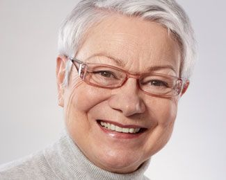 Elderly woman wearing glasses smiling