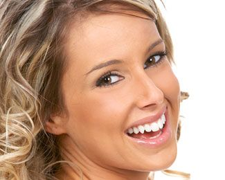 Blonde woman with curly hair smiling