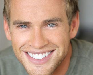 Blonde male with blue eyes smiling