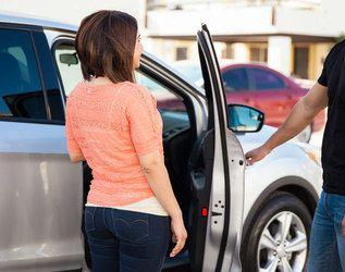 A woman gets into a car