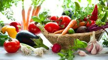 Healthy, fresh vegetables in a basket, sitting on a table