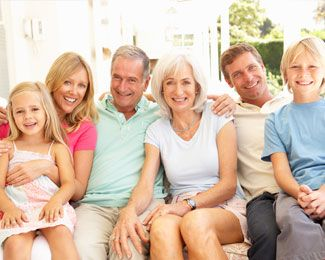 A family of grandparents, parents, and children - all with healthy smiles