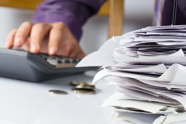 tax papers and calculator