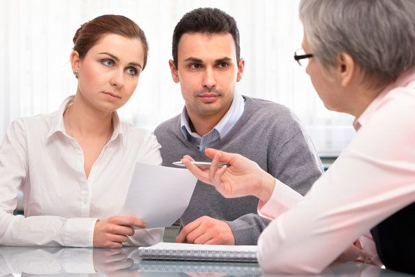 couple consulting with lawyer