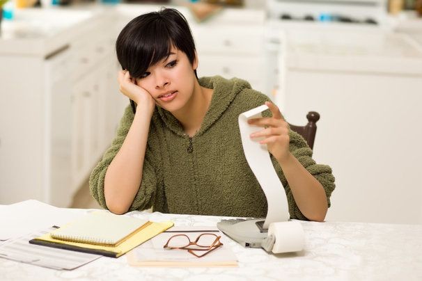 Woman feeling stressed by bills