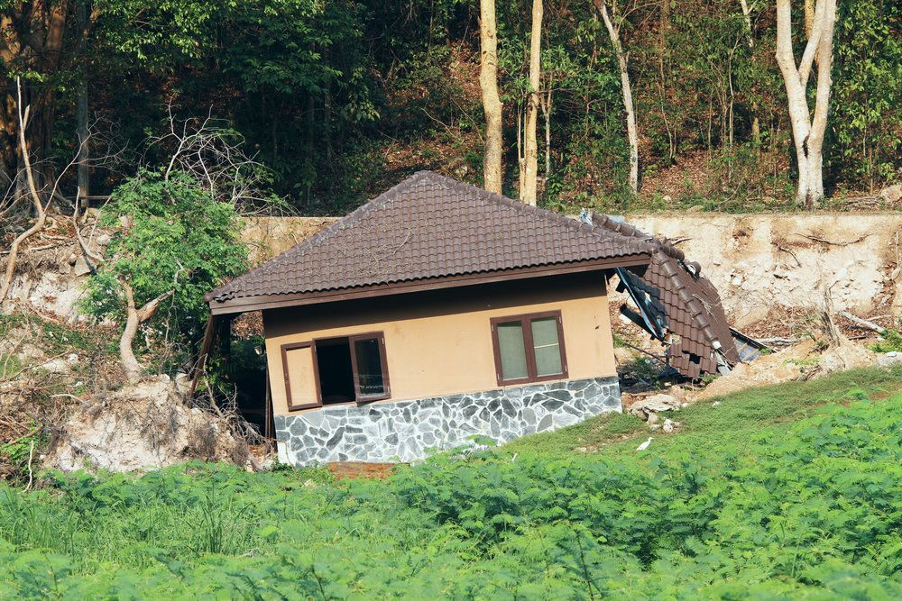 Home damaged by landslide