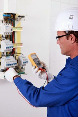 man working with circuit breaker