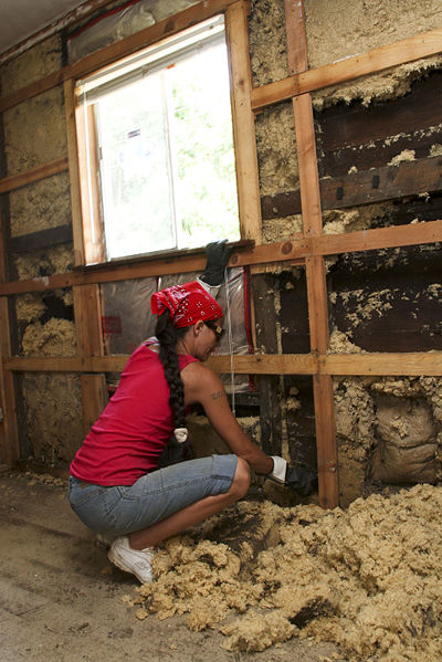Woman tending to damaged home