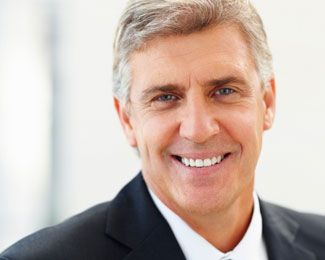 a middle-aged man smiles