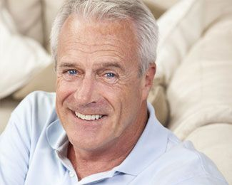 an older man smiles after his dental bonding treatment