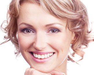 Smiling woman with curly short blond hair
