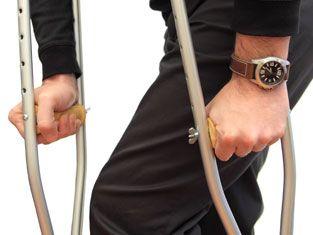 man using crutches