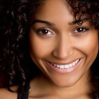 Smiling woman with curly brown hair