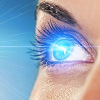 Supernatural looking woman's bright blue eye shooting sparks