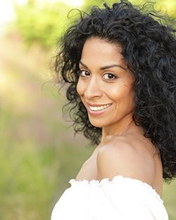 Hispanic woman smiling outside