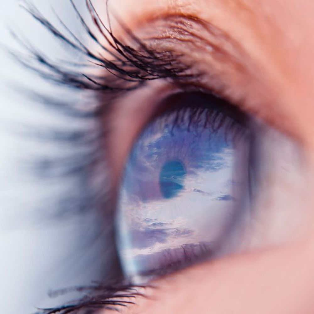 A close up of a foggy blue eye