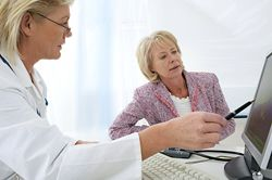 Woman discussing costs with her doctor