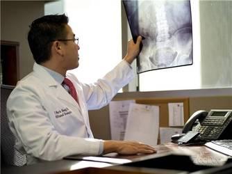 Dr. Mark Hong examining an x-ray