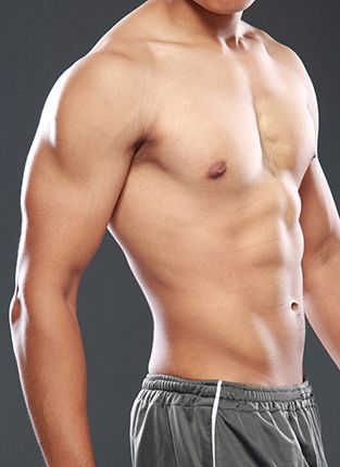 Close view of male torso, shirtless, focusing on pectorial area