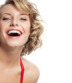 Blond woman laughing with gorgeous white smile.