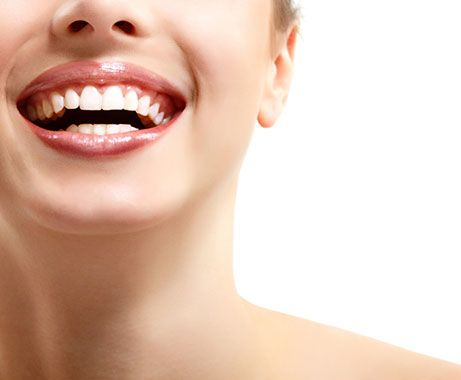 Laughing woman with white teeth.