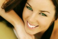 Smiling woman with bright, white teeth