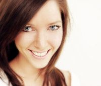 Smiling woman with blue eyes and brown hair