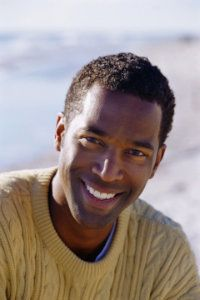 Smiling African American man with very white teeth