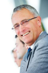 Smiling businessman with glasses and gray hair