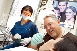 Dr. Degel examines a patient's smile