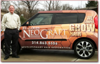 "Dr. Moore stands beside car painted with ""Neo Graft"" sign"