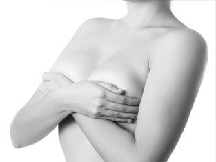 Woman cupping her breasts