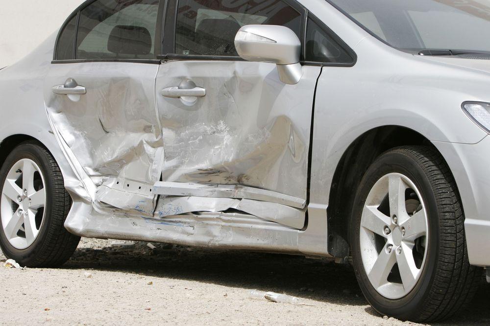 A badly dented car