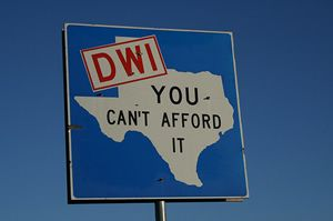"""A DWI sign including the State of Texas and a warning, """"You Can't Afford It."""""""
