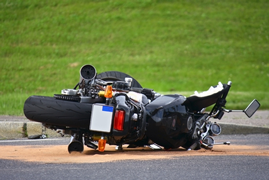 motorcycle lying on side on residential road