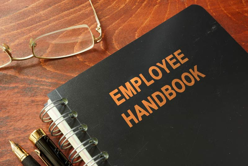 Employee handbook and reading glasses