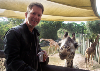 Stephen G. Charpentier with a giraffe