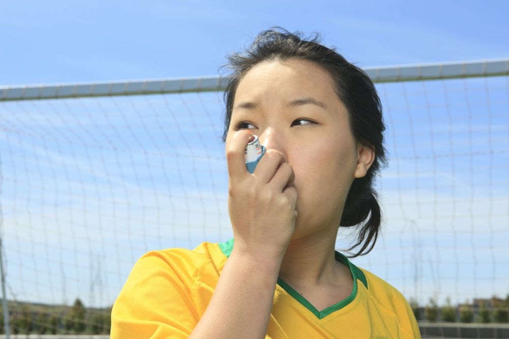 Photo of a girl with an asthma inhaler