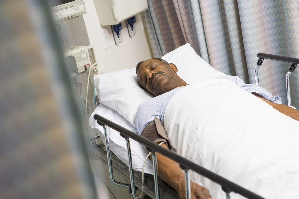 Photo of a man on a hospital gurney