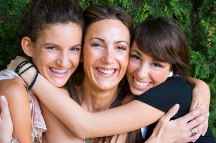 Mother with daughters who may be at an appropriate age to have their wisdom teeth removed
