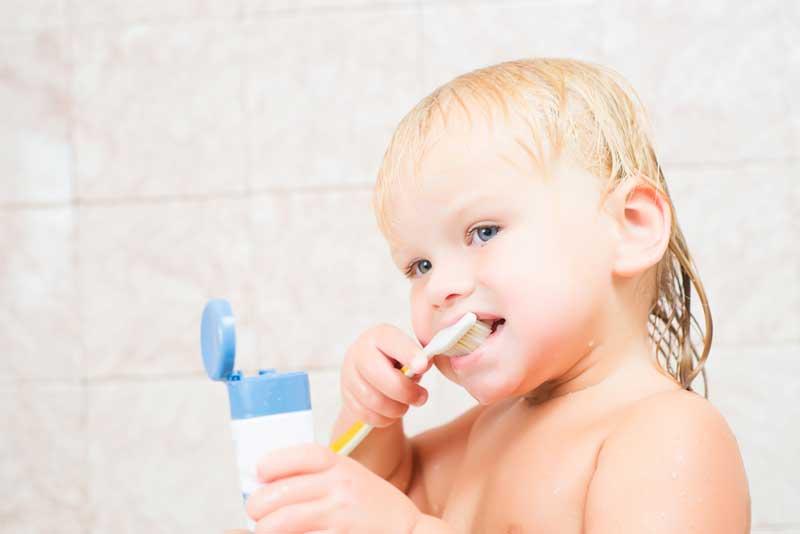 baby brushing his teeth