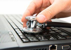 Stethoscope on keyboard of laptop