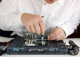 Man repairing laptop