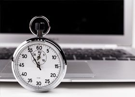 Stopwatch in front of a laptop