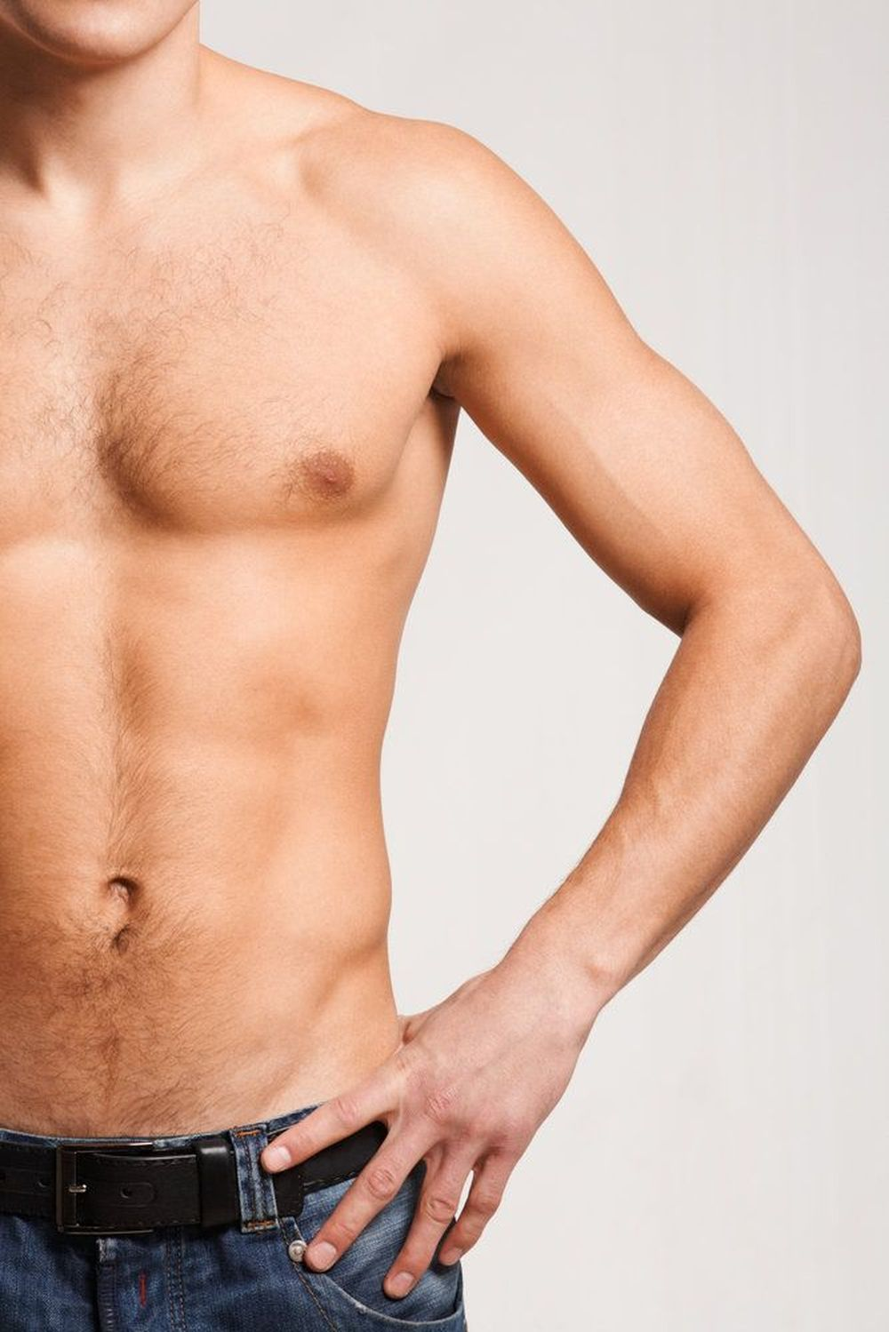 Man's masculine torso with hand on hip