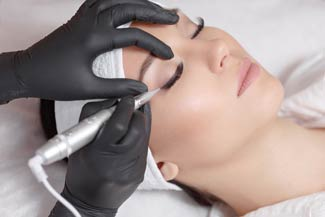 A woman undergoes a permanent makeup treatment