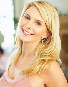 Smiling blond woman with straight, white teeth