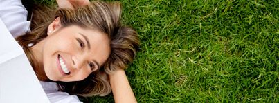 Woman lying on grass and smiling