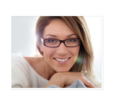 Woman wearing glasses and smiling