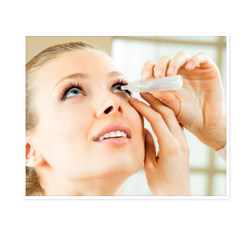 Woman putting in eye drop